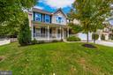 full front yard and flat driveway - 10303 ILIAMNA CT, NEW MARKET