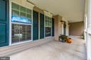 Large covered porch - 10303 ILIAMNA CT, NEW MARKET