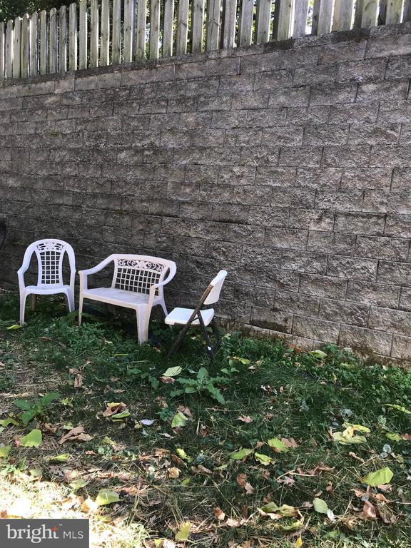 Backyard  at Neighbor's Retaining Wall - 2411 S MONROE ST, ARLINGTON