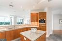 Kitchen island. - 1881 N NASH ST #1902, ARLINGTON