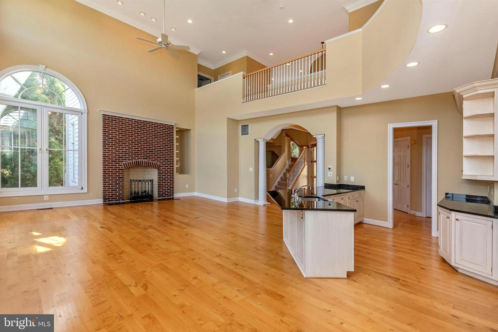 Family room featuring a brick fireplace. - 10035 PEBBLE BEACH TER, IJAMSVILLE