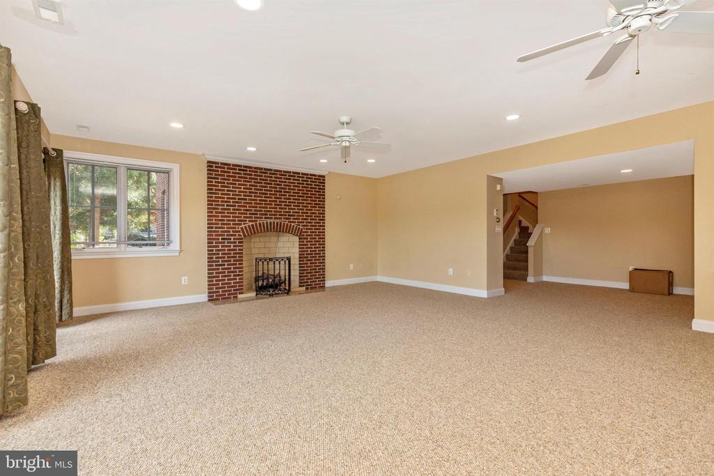 Amazing lower level rec room with fireplace. - 10035 PEBBLE BEACH TER, IJAMSVILLE