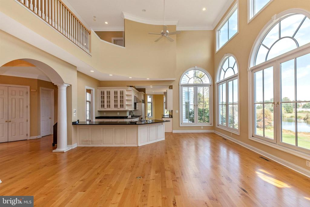 Open concept from family room through kitchen. - 10035 PEBBLE BEACH TER, IJAMSVILLE