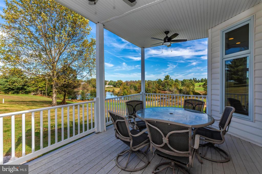 Main level covered deck off dining room. - 10035 PEBBLE BEACH TER, IJAMSVILLE