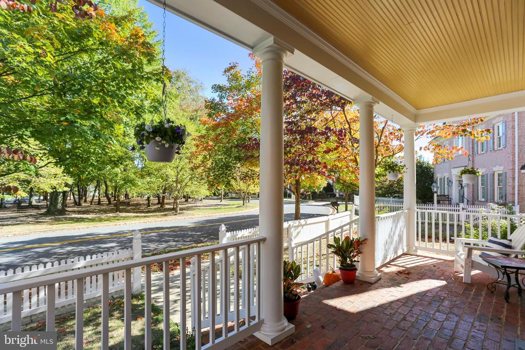 Masonry front porch overlooks Daffodil Park - 616 FIREHOUSE LN, GAITHERSBURG
