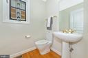 Powder room with unique stained glass - 9706 WOODLAKE PL, NEW MARKET