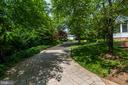 Paved winding drive leads to private rear yard - 3812 MILITARY RD, ARLINGTON