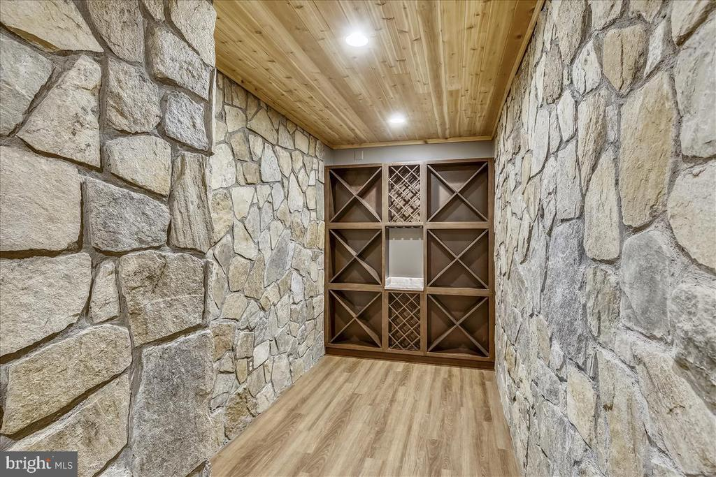 Wine cellar with stone walls and cedar ceiling - 2222 KING ST, ALEXANDRIA