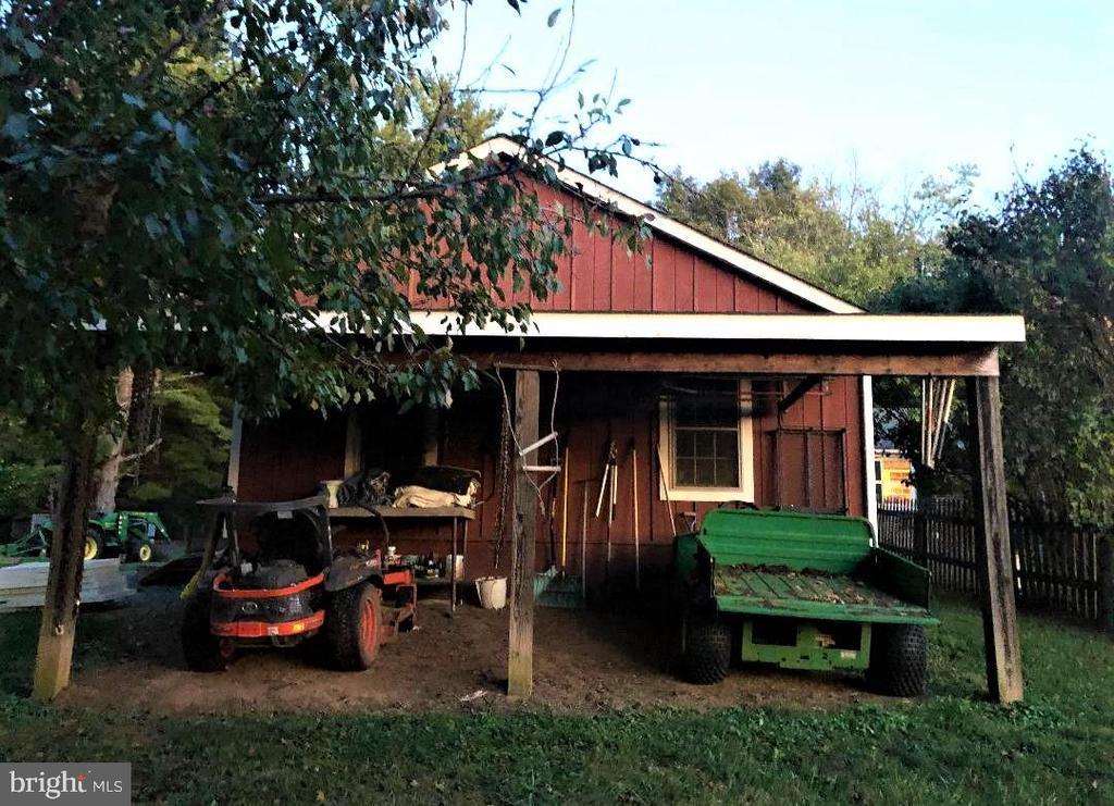Shed side of 3 bay board & batton detached garage. - 18217 CANBY RD, LEESBURG