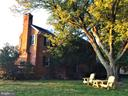 Side yard adirondacks under the oaks! - 18217 CANBY RD, LEESBURG