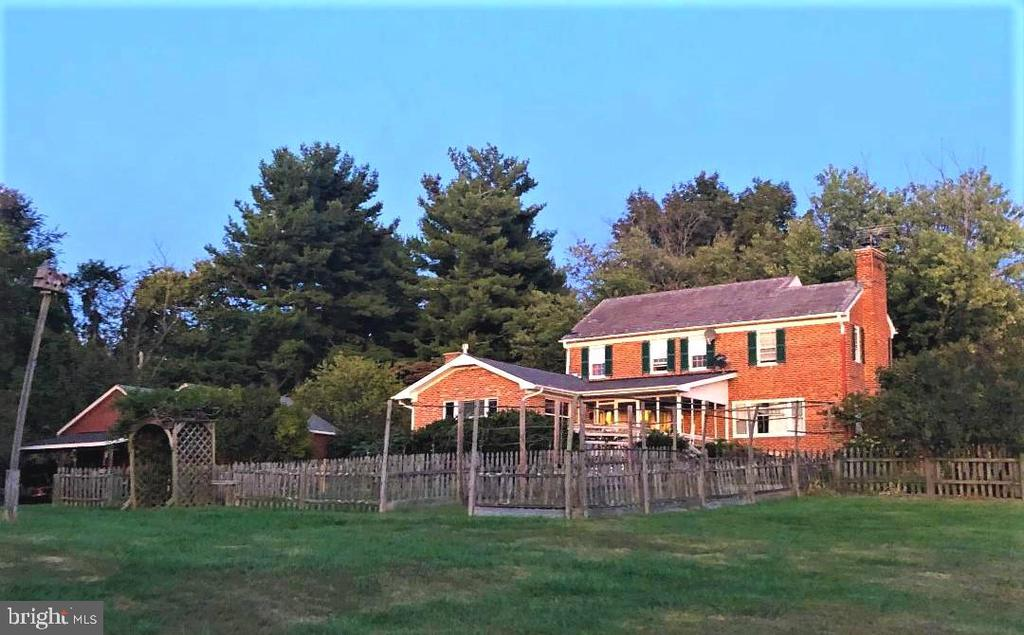 Rear of the home toward the gardens.  Barn behind! - 18217 CANBY RD, LEESBURG
