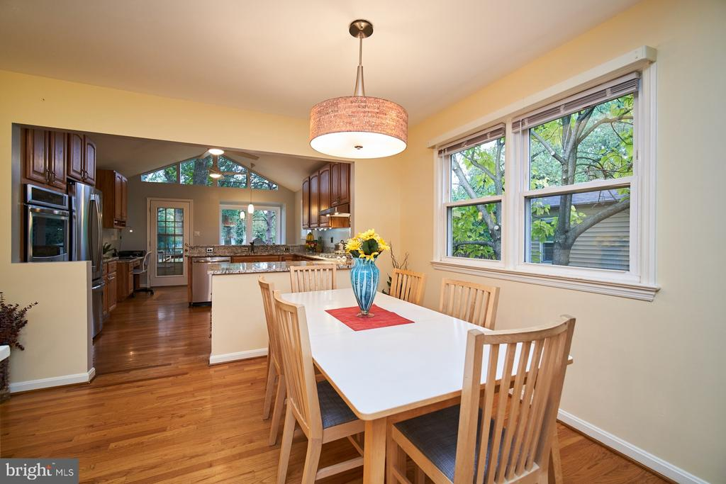 Dining area with view of open kitchen - 4811 OGLETHORPE ST, RIVERDALE