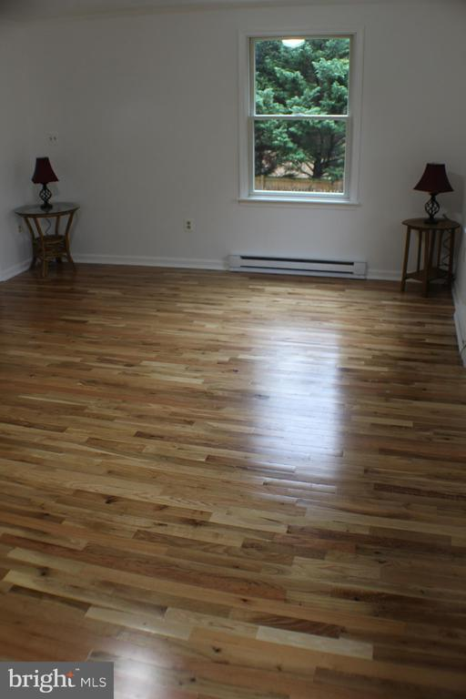 Master bed With new hardwood floors - 7738 TALBOT RUN RD, MOUNT AIRY