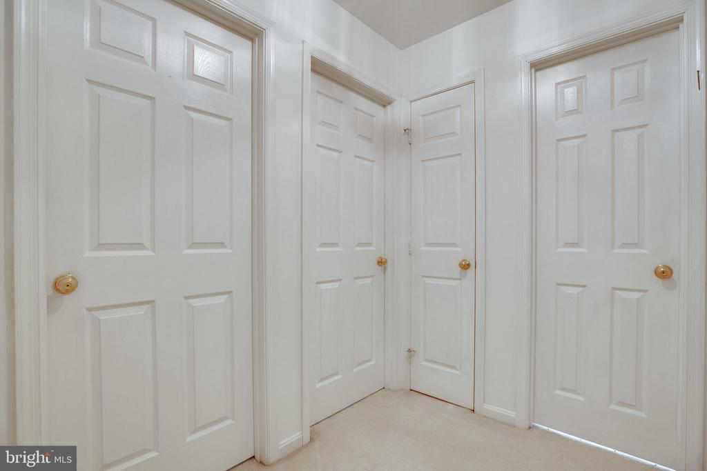 Upstairs Hallway - showing Linen Closet Door - 6858 KERRYWOOD CIR, CENTREVILLE