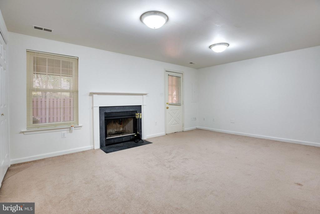 Lower Level Rec Room / Family Room w/ Fireplace - 6858 KERRYWOOD CIR, CENTREVILLE