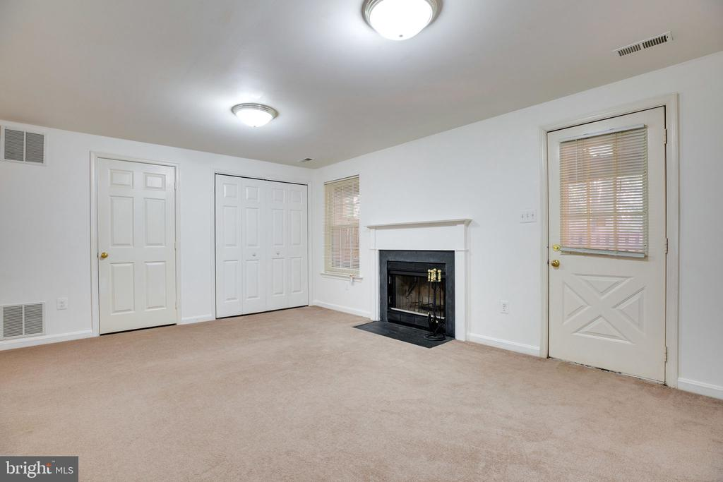 Rec Room, showing Fireplace and Walk-Out Door - 6858 KERRYWOOD CIR, CENTREVILLE