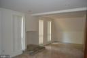Family Room with powder room - 7207 RIDGEWAY DR, MANASSAS