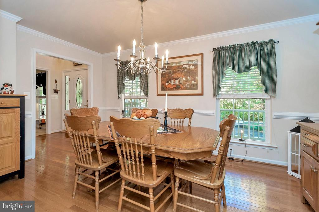 Expansive formal dining room off of kitchen - 404 WILDERNESS DR, LOCUST GROVE