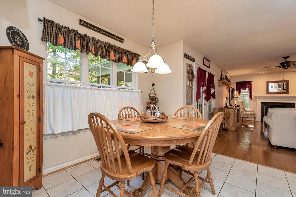 Light-filed eating area opens to family room - 404 WILDERNESS DR, LOCUST GROVE