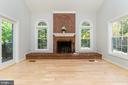 Wood-burning fireplace with brick facade - 4917 EDGE ROCK DR, CHANTILLY