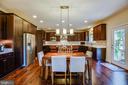 Absolutely stunning kitchen with hardwood floors! - 11206 VALOR BRIDGE DR, SPOTSYLVANIA