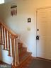 Hardwood stair/rails off 2nd front entrance. - 18217 CANBY RD, LEESBURG