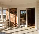 Screen porch off family/game double door. - 18217 CANBY RD, LEESBURG