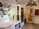 Wrought iron, porcelain & built ins mud room. - 18217 CANBY RD, LEESBURG