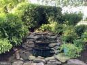 Soothing water fall fountain in backyard - 18375 FAIRWAY OAKS SQ, LEESBURG