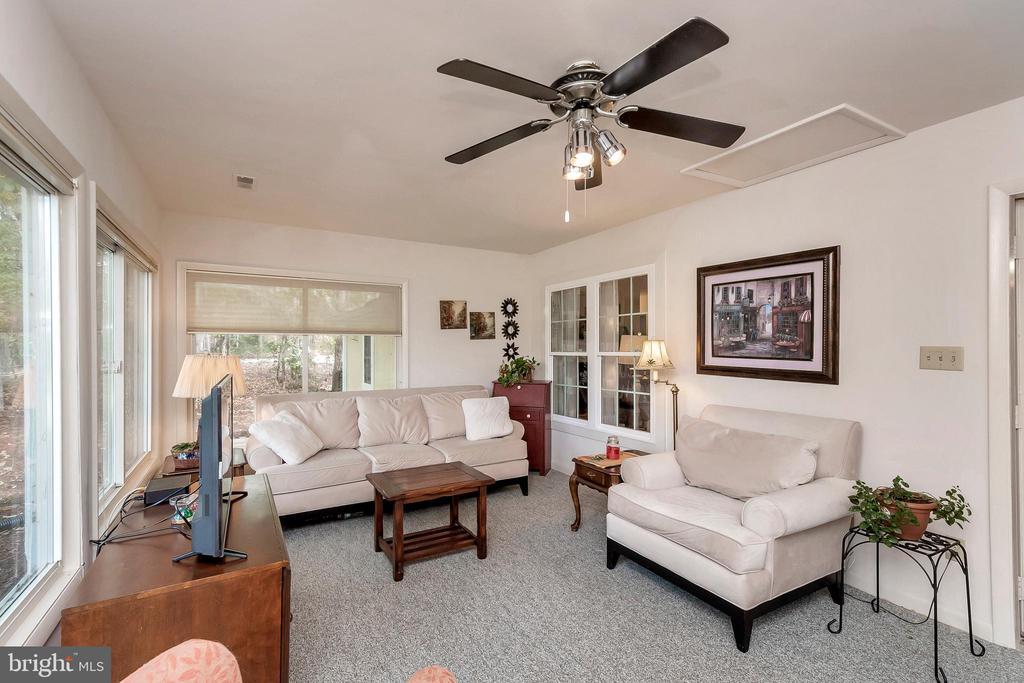 Sun Room leads to garage & patio - 143 EAGLE CT, LOCUST GROVE