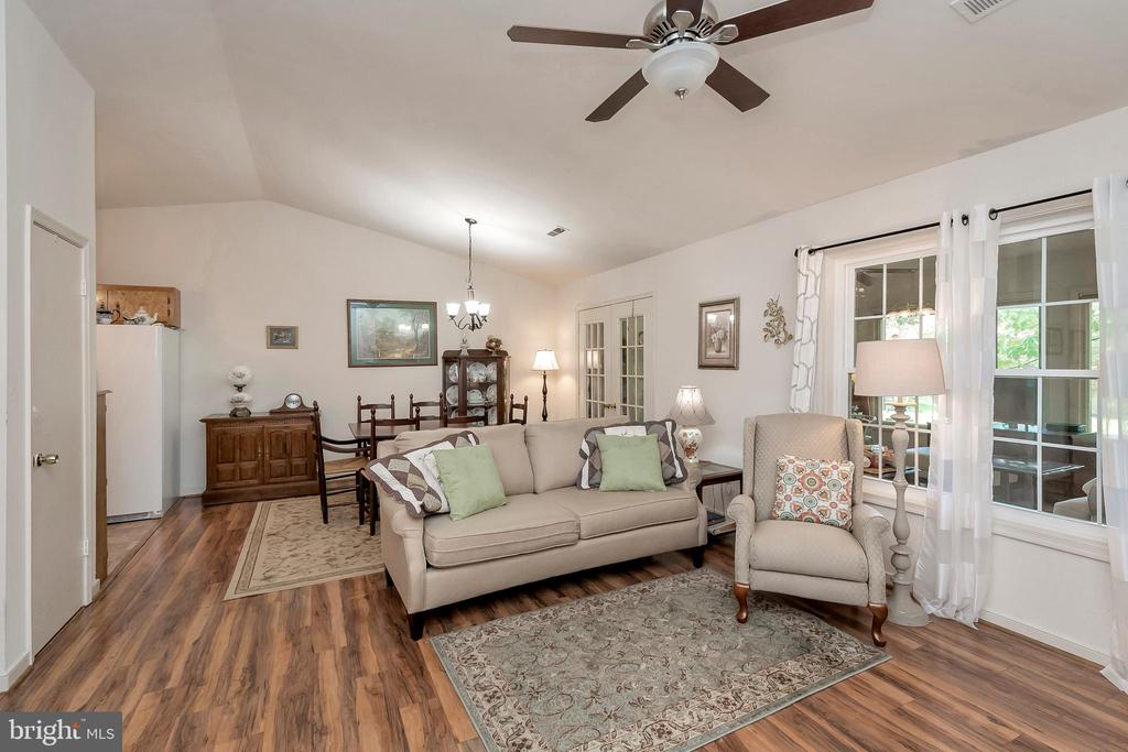 Living Room with views to dining & sun room - 143 EAGLE CT, LOCUST GROVE