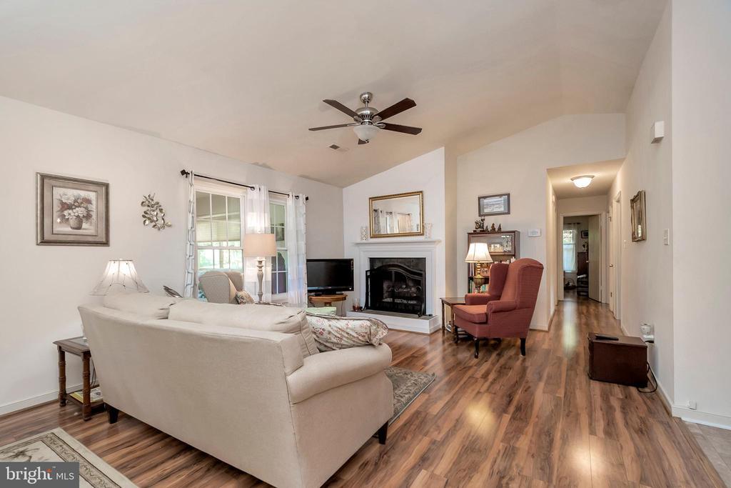 Living Room & view to bedroom hallway - 143 EAGLE CT, LOCUST GROVE