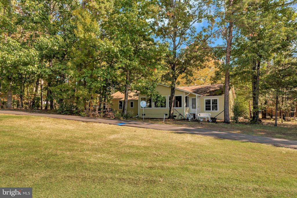 back of home from golf course - 143 EAGLE CT, LOCUST GROVE