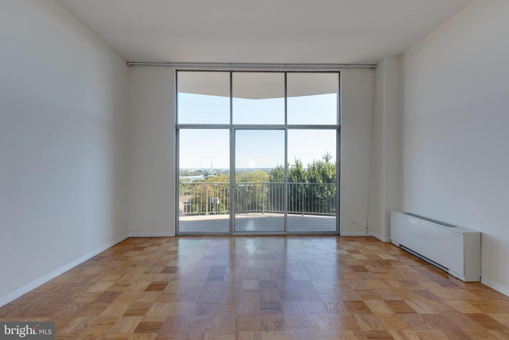 LR with wall of glass opening to balcony & view - 1200 N NASH ST #538, ARLINGTON