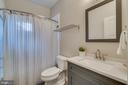 En-suite bathroom off main level bedroom - 512 N LITTLETON ST, ARLINGTON