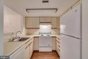 Kitchen open to dining and living room. - 1951 SAGEWOOD LN #509, RESTON
