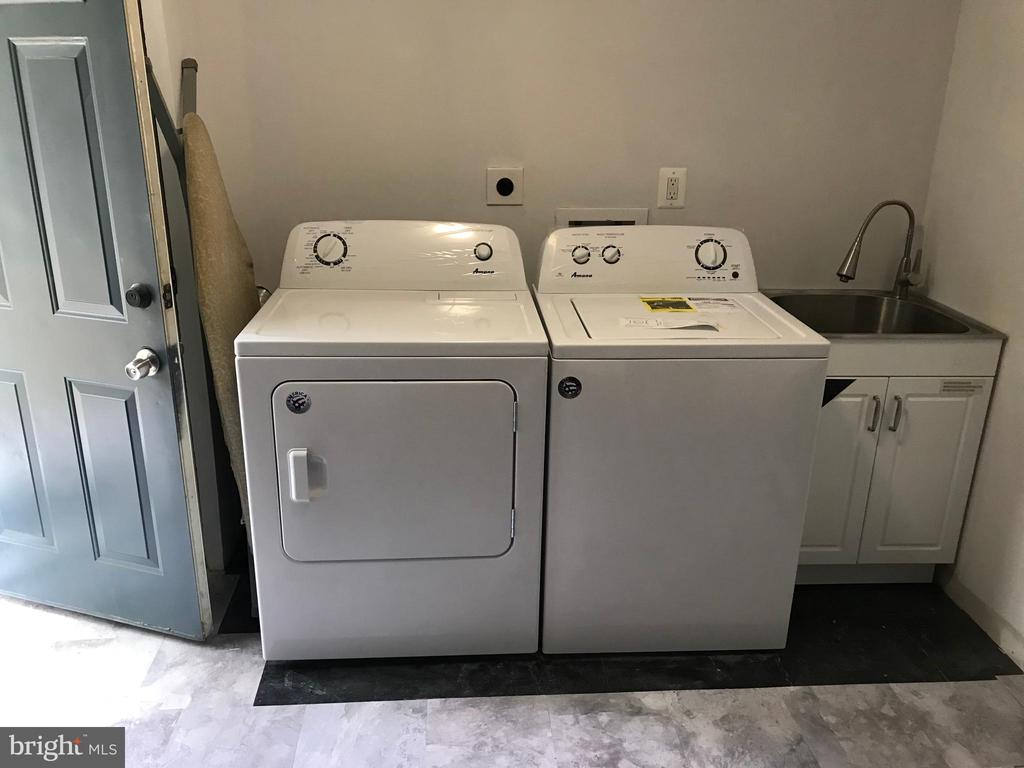 Laundry /HVAC Room with sink and rear exit. - 2411 S MONROE ST, ARLINGTON