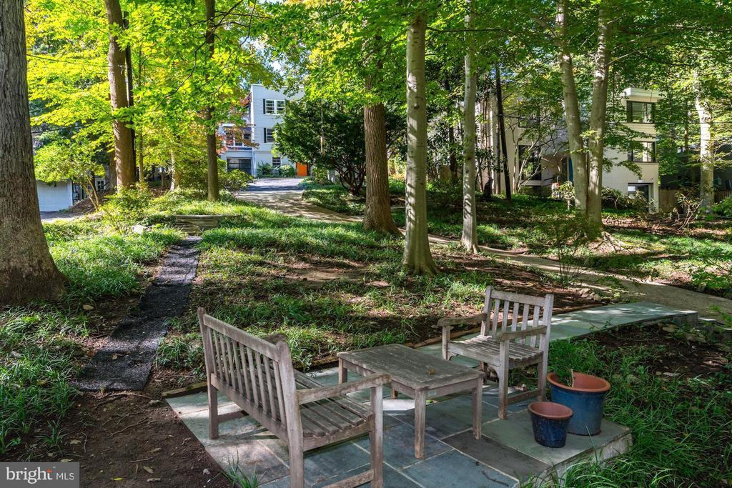 Charming seating area tucked along the driveway - 2318 44TH ST NW, WASHINGTON