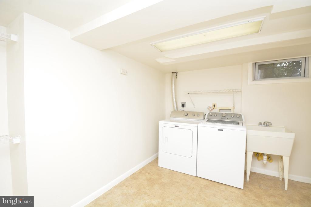 Lower level laundry area with utility sink - 4747 ARLINGTON BLVD, ARLINGTON