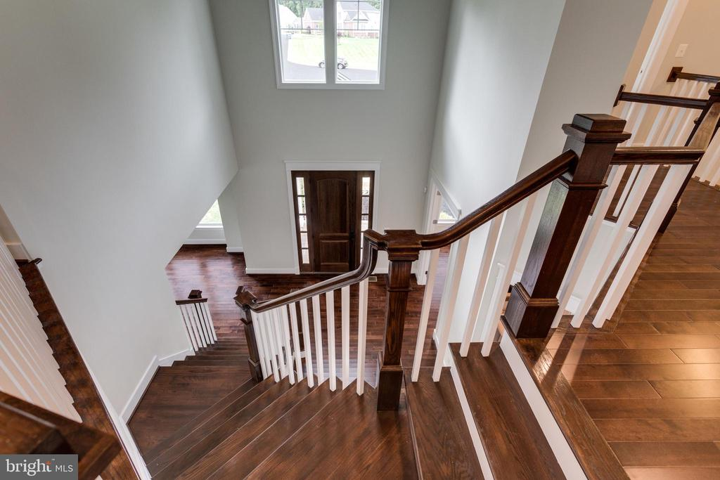 FORMAL STAIRCASE.  2ND STAIRCASE OFF FAMILY-ROOM. - 212 TAPAWINGO RD SE, VIENNA
