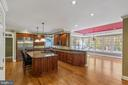 Large kitchen with seated island - 15093 LAUREL HILL CT, LEESBURG