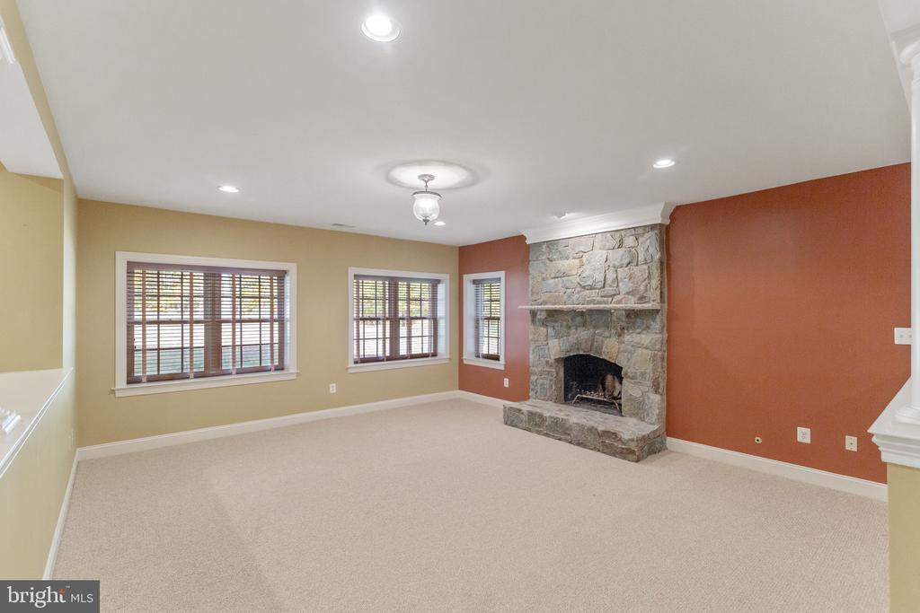 Stone, wood-burning  fireplace in Family Room - 15093 LAUREL HILL CT, LEESBURG