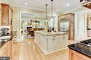 Oversized Kitchen Island With Pendant Lighting - 4830 CASTLEBRIDGE RD, ELLICOTT CITY