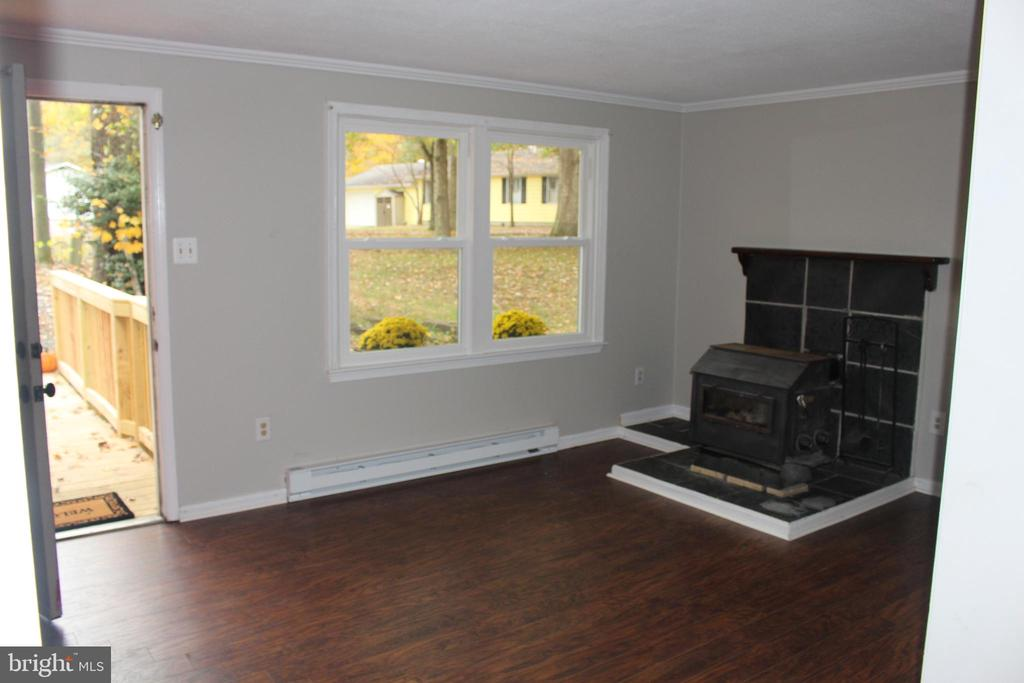 Family room with wood burning stove - 200 NORTHVIEW DR, FREDERICKSBURG