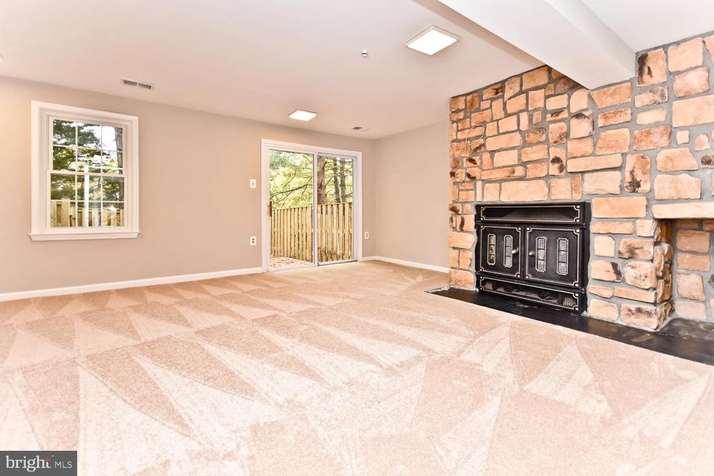 Family Room with Wood Burning FP & SGD to Rear - 5663 CHELMSFORD CT, BURKE