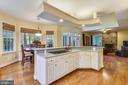 Kitchen island with prep sink & 5-burner cooktop - 10680 ALLIWELLS CT, OAKTON