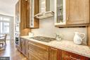 Up to date kitchen with paneled refrigerator - 5132 WILLET BRIDGE RD, BETHESDA