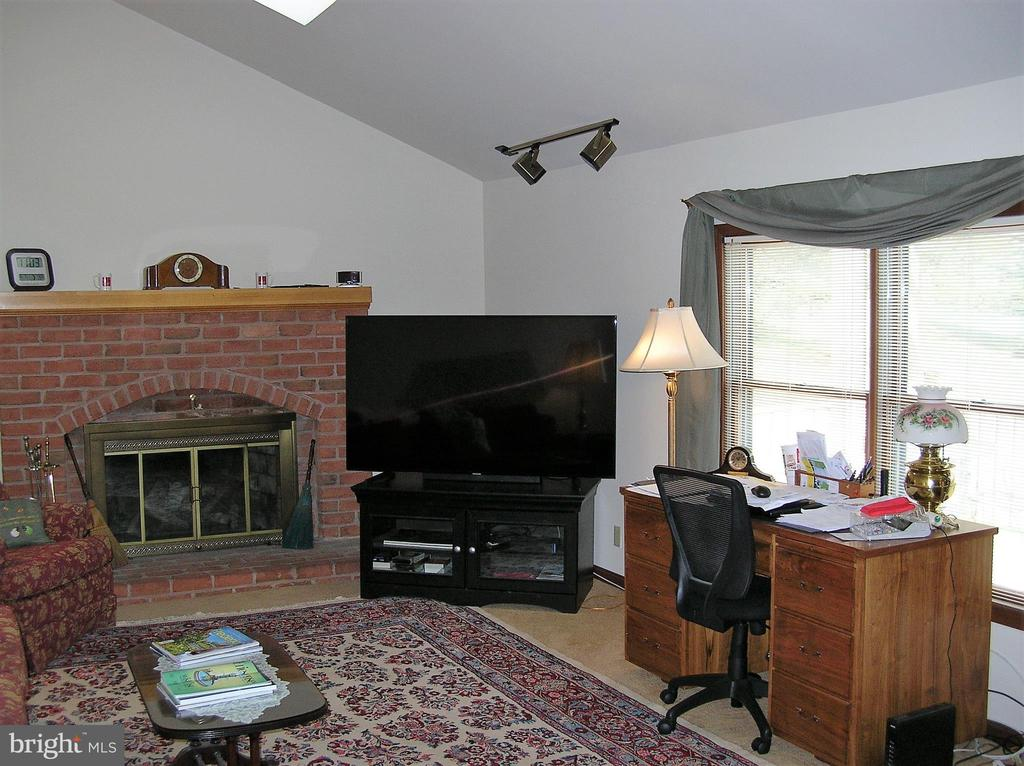Family room with gas fireplace and vaulted ceiling - 4970 FLOSSIE AVE, FREDERICK