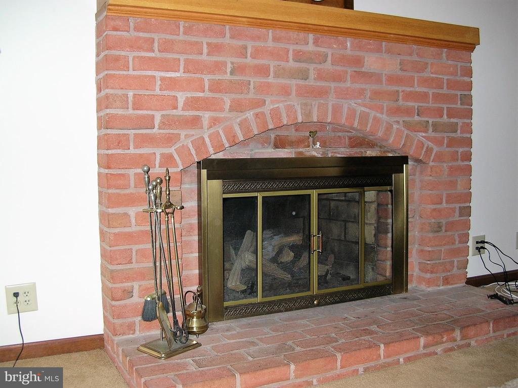Brick fireplace with gas logs - 4970 FLOSSIE AVE, FREDERICK