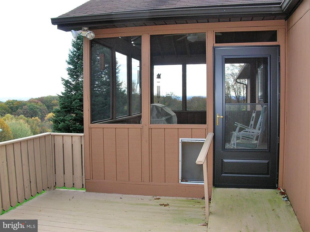 Entrance to the screened porch from the deck - 4970 FLOSSIE AVE, FREDERICK